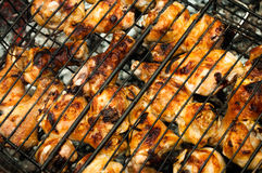 Browned chicken legs in a lattice grill picnic outdoors Stock Image