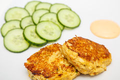 Browned Crab Cakes with Cucumber Slices Royalty Free Stock Photo