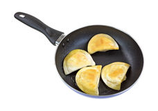 Browned pierogies in a black skillet Royalty Free Stock Images