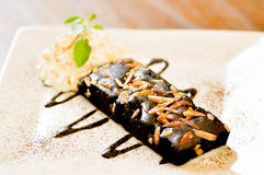 Brownie  with almond and cream Royalty Free Stock Images