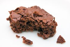 Brownie with bite-marks on white Royalty Free Stock Photos