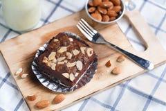 Brownie cake. Chocolate brownie almond cake on wood plate stock image