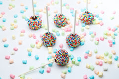 Brownie cake pops with color sugar pearls and marshmallow Royalty Free Stock Photos