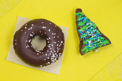 Brownie cake in  shape of  triangle and brown glazed donut o Stock Image