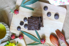 Brownie cake with tea. Brownie cake with hot tea Royalty Free Stock Images