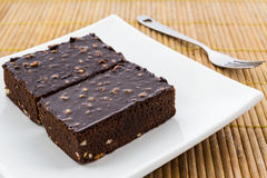 Brownie cake on a white plate. Royalty Free Stock Photography