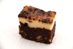 Brownie Cheese cake on a white plate. Stock Photo