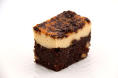 Brownie Cheese cake on a white plate. Royalty Free Stock Photos