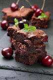 Brownie with cherries and mint Stock Photo