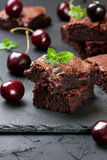 Brownie with cherries and mint Royalty Free Stock Photography