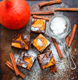 Brownie. Chocolate brownies with pumpkin and cinnamon. A traditional American dessert Royalty Free Stock Photos