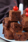 Brownie chocolate cakes with cherries Stock Images