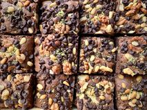 Brownie cubes with chocolate pieces and nuts, top view.Flat lay food royalty free stock images