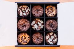 Brownie cupcake topping with various ingredients such as almond, caramel and chocolate chips Stock Image