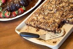 Brownie de nuez del caramelo Fotografía de archivo