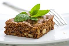 Brownie del chocolate caliente con las nueces y la vainilla Imagenes de archivo