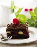 Brownie del chocolate con las frambuesas Foto de archivo libre de regalías