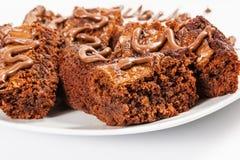 Brownie del chocolate en la placa blanca Fotografía de archivo libre de regalías