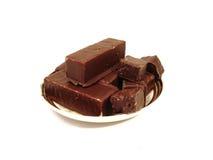 Brownie del cioccolato su una zolla sopra priorità bassa bianca Immagine Stock