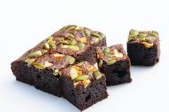 Brownie dessert on white background. Brownie dessert and grains topping on white background Stock Photography