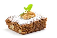 Brownie do chocolate quente com nozes e baunilha fotos de stock royalty free