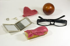 Brownie, Eclair, glasses, mirror, safety pin with pearl, orange, Royalty Free Stock Photography
