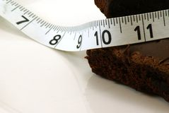 Brownie with Measuring Tape Stock Images