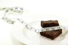 Brownie with Measuring Tape Royalty Free Stock Images