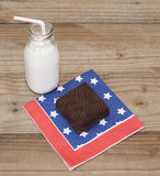 Brownie and Milk on Red, White, and Blue Royalty Free Stock Photos
