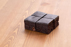 Brownie. Roll on wood table Stock Photo