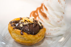Brownie tart with sliced almond and vanilla ice cream Stock Image