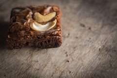 Brownie with topping Cashew putting on a wooden desk stock photos