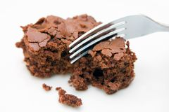 Brownie on white with fork. A fresh homemade chocolate brownie on a white background with fork Stock Photo