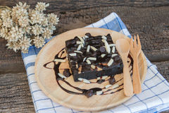Brownie on wood plate Royalty Free Stock Images