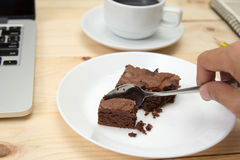 Brownie on wooden table. Closeup brownie on wooden table Stock Photo