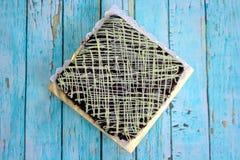 Brownies στον τετραγωνικό πίνακα Στοκ Εικόνες