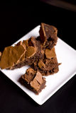 Brownies!. Chocolate Brownies on a White Platter on a restaurant table Stock Image