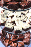 Brownies. Three plates of brownies sitting on the table Royalty Free Stock Photos