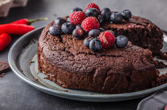 Brownies cake with chilli and berrries. Brownies cake delish with berries, milk and eggs behind as background royalty free stock photo