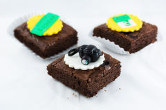 Brownies with camera model on top. Three brownies on white background royalty free stock image