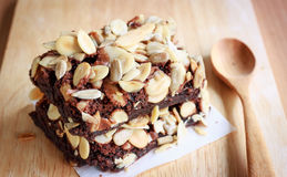 Brownies. Chocolate brownie cake slice serve on wooden plate Royalty Free Stock Photos