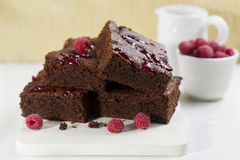 Brownies com framboesas Foto de Stock Royalty Free