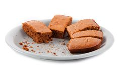 Brownies  and crumbs on gray plate Royalty Free Stock Photo