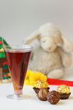 Brownies and Drinks. The red  wine beverage and hazelnut chocolate Royalty Free Stock Photography