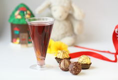 Brownies and Drinks. The red  wine beverage and hazelnut chocolate Stock Photography