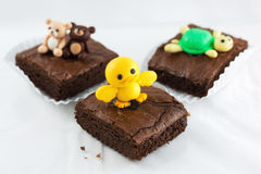 Brownies with duck model on top. Three brownies on white background Stock Photography