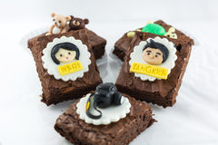 Brownies with girl and boy cartoon on top Stock Images