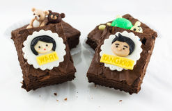 Brownies with girl and boy model on top. Three brownies on white background Royalty Free Stock Photo