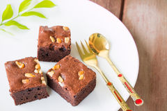 Brownies and golden spoon with cup of coffee Royalty Free Stock Photo