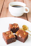 Brownies and golden spoon with cup of coffee Stock Photos